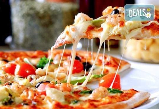 Вкусно хапване от ресторант Феличита! Включва италианска пица с кашкавал!